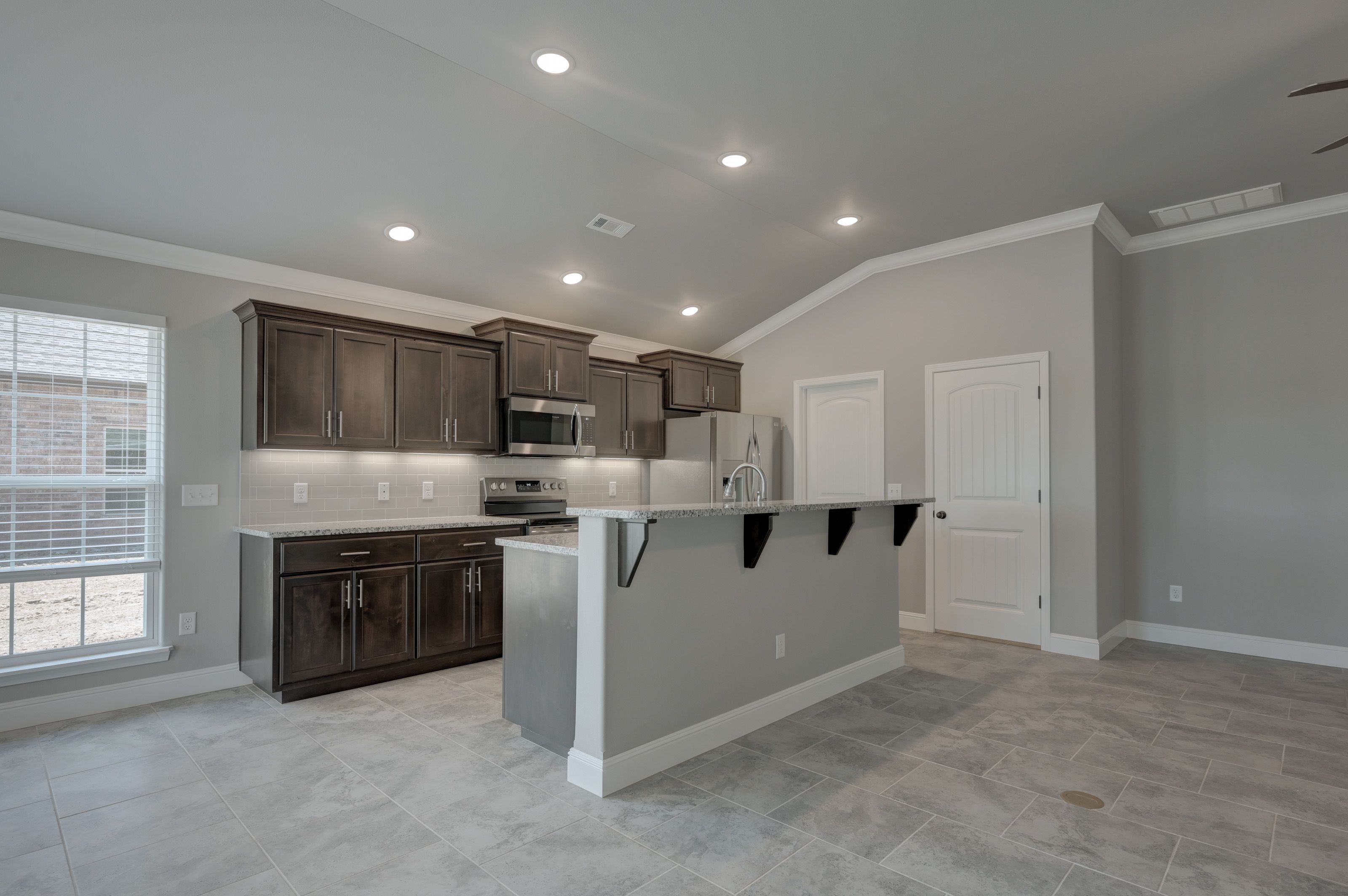 Kitchen featured in the 1700KI Series By Schuber Mitchell Homes in Joplin, MO