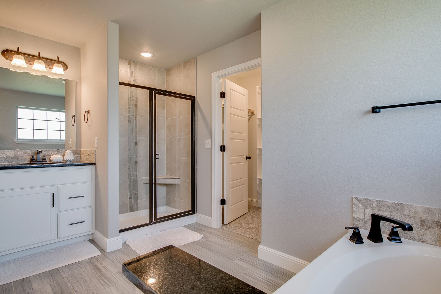 Bathroom featured in the 1700KI Series By Schuber Mitchell Homes in Fayetteville, AR