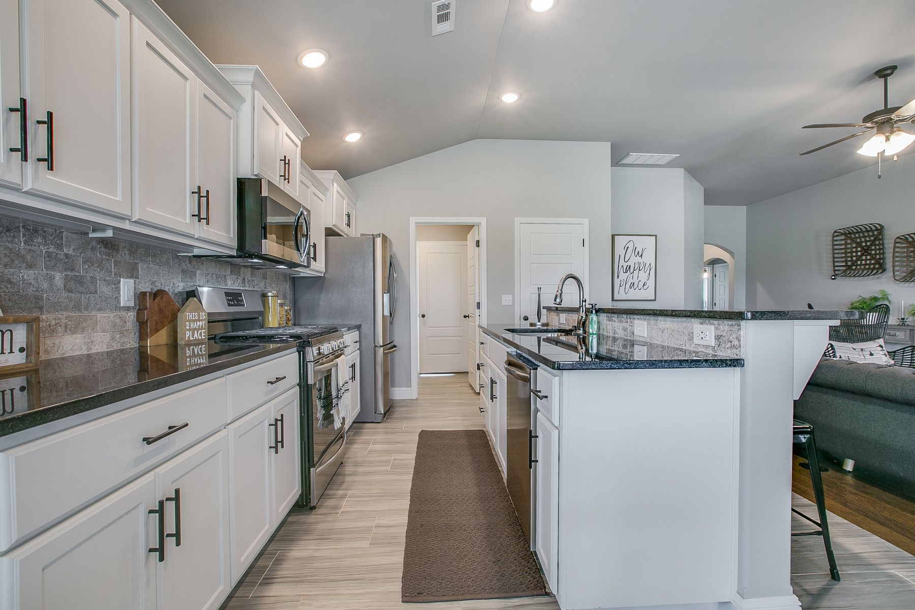 Kitchen featured in the 1700KI Series By Schuber Mitchell Homes in Fayetteville, AR