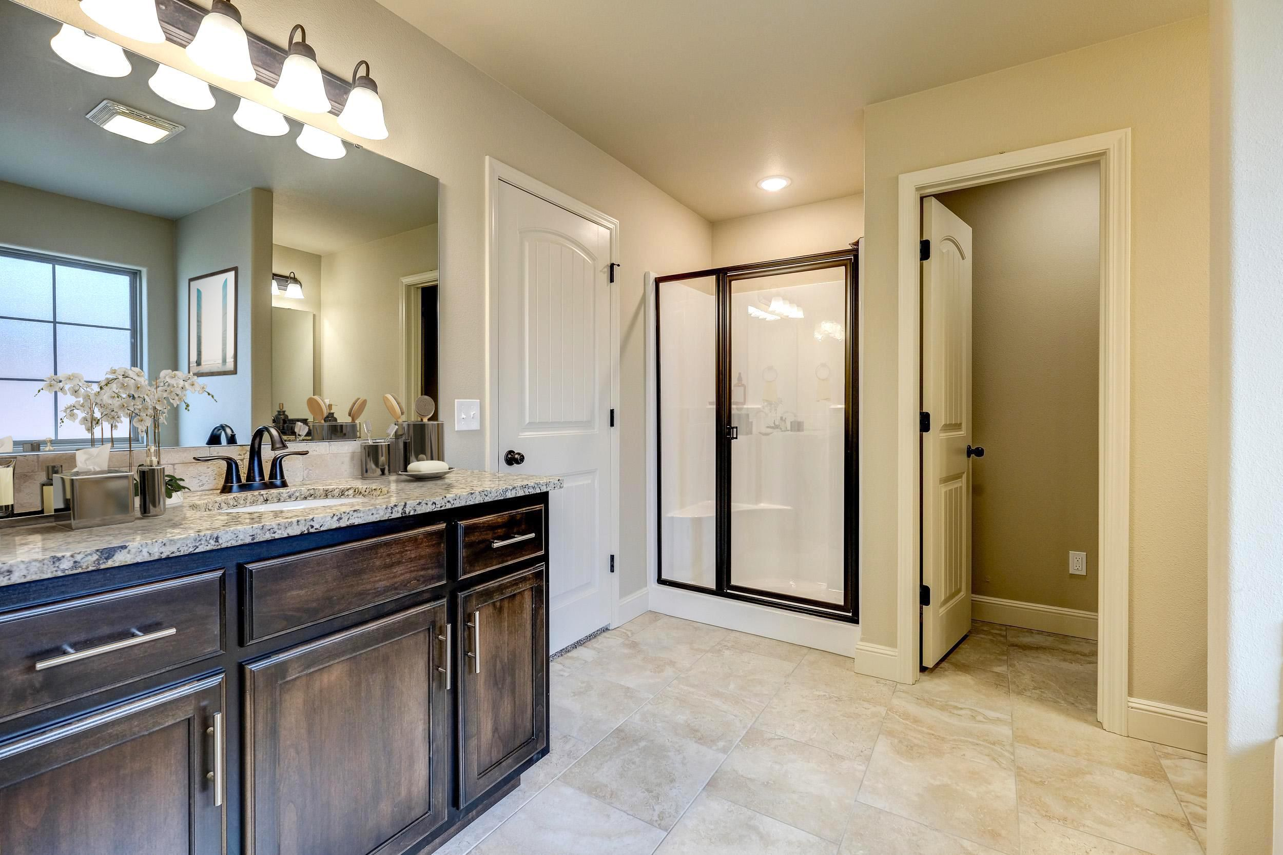 Bathroom featured in the 1650KI Series By Schuber Mitchell Homes in Fayetteville, AR