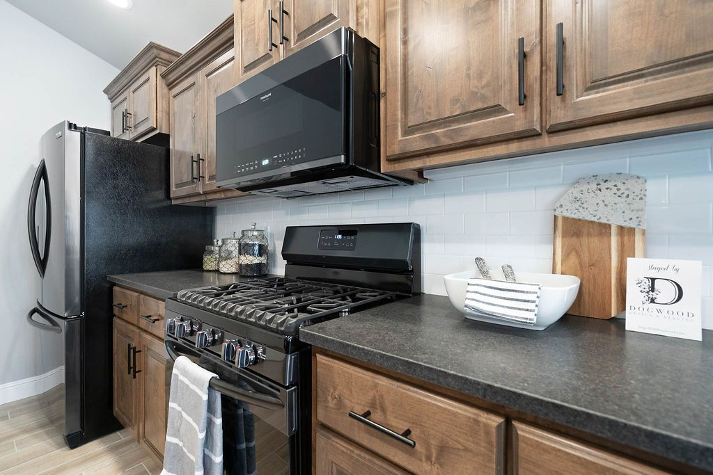 Kitchen featured in the 2300KI Series By Schuber Mitchell Homes in Joplin, MO