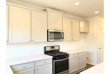 Kitchen-in-from MLS-at-Harmony on the Lakes-in-Holly Springs