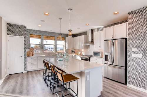 Kitchen-in-Plan 2203-at-Crescendo at Central Park-in-Highlands Ranch