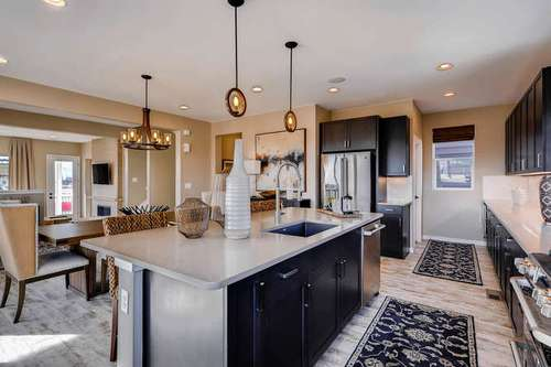 Kitchen-in-Plan 2205-at-Crescendo at Central Park-in-Highlands Ranch