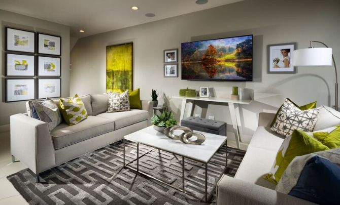 Plan 3 living room with television, area rug, two :Plan 3: Living Room