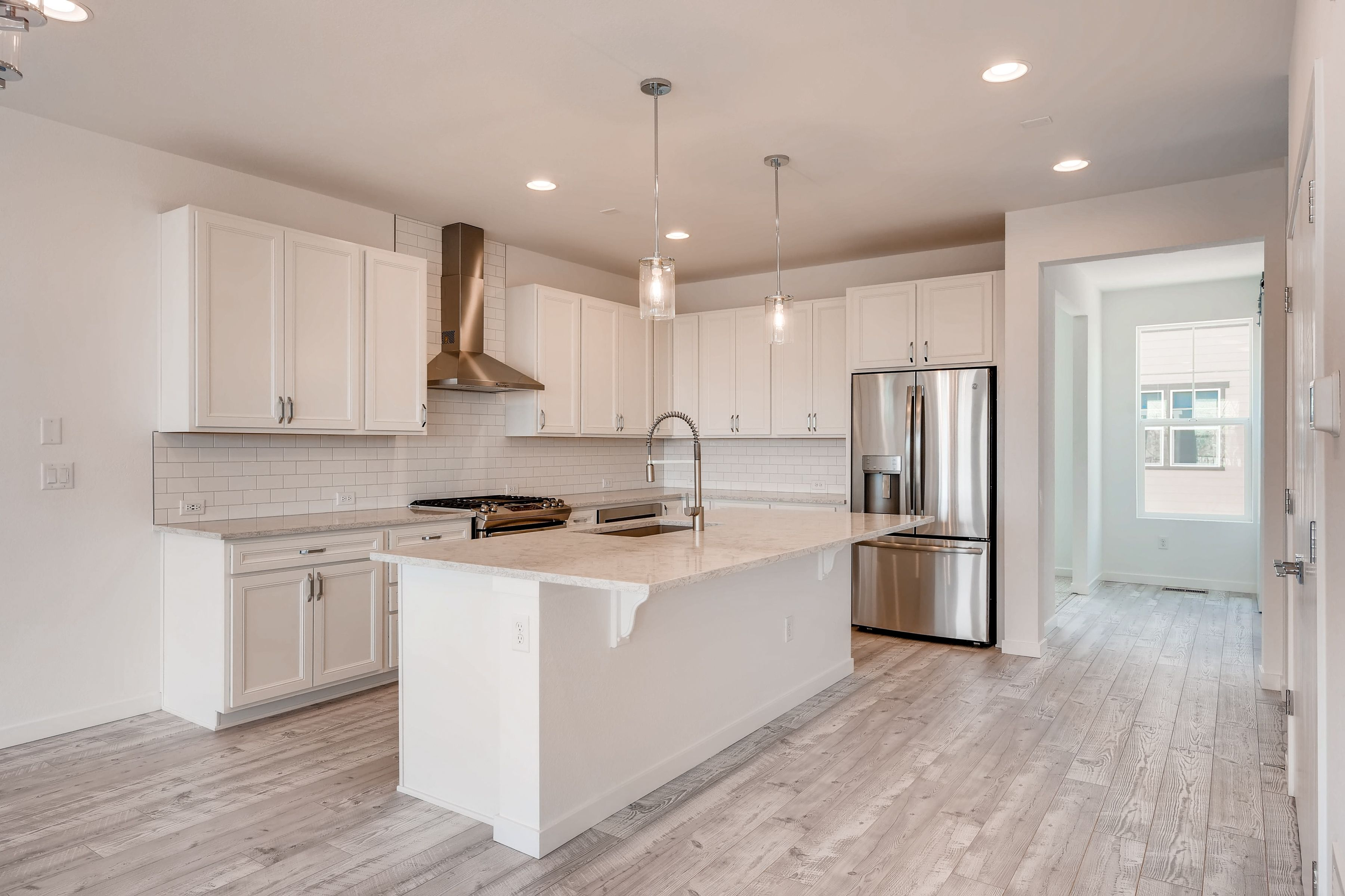 Kitchen-in-Plan 2202-at-Crescendo at Central Park-in-Highlands Ranch