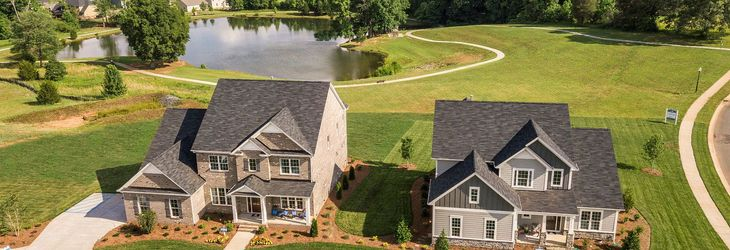 Two model homes located on a pond:Chandler & Camden models