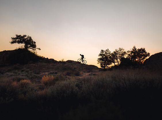 Man Riding Bike in Desert