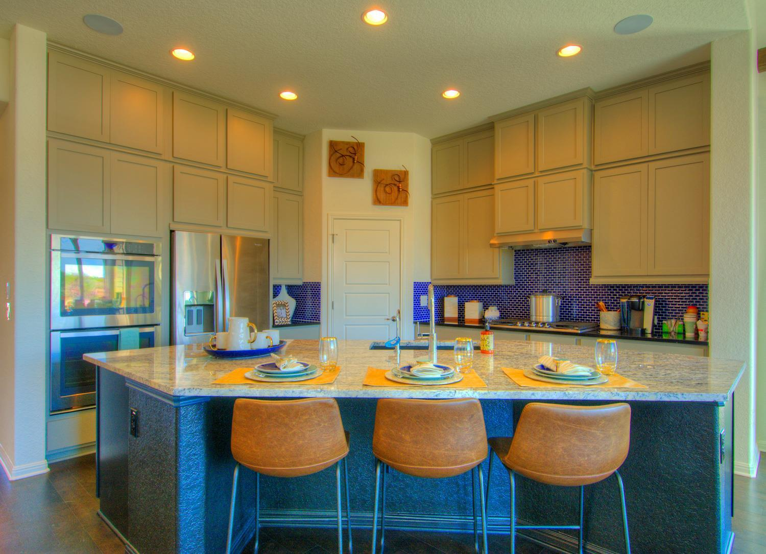 Kitchen featured in the Roma Weston Oaks By Sitterle Homes in San Antonio, TX