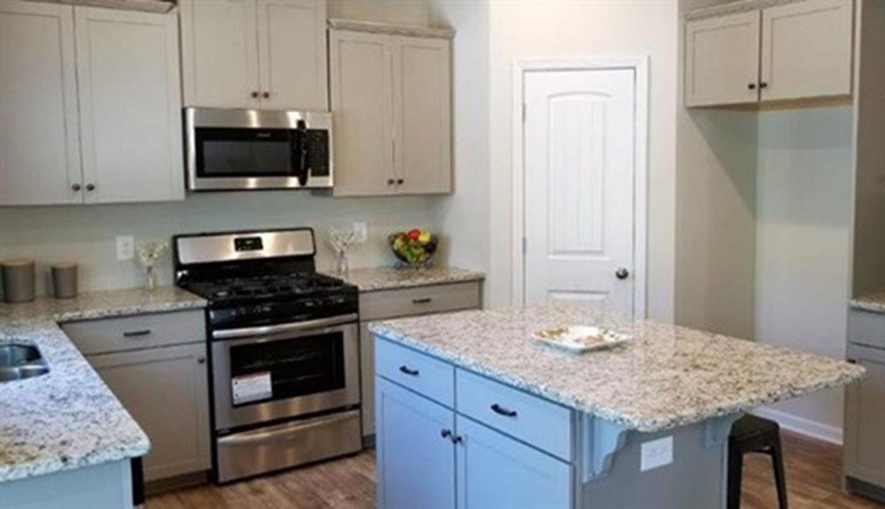 Kitchen featured in The Benson By Smith Douglas Homes in Birmingham, AL