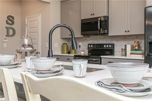 Kitchen-in-The Oxford G-at-Villages at Thorncrest-in-Tucker