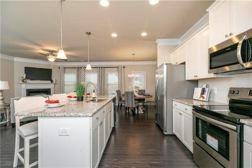 Kitchen-in-The Oxford H-at-Villages at Thorncrest-in-Tucker