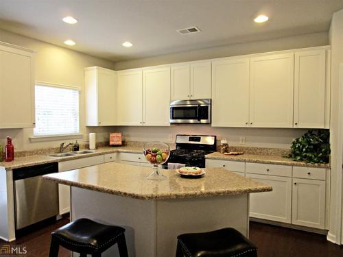 Kitchen-in-The McPherson-at-Woodbury Estates at Newnan Crossing-in-Newnan