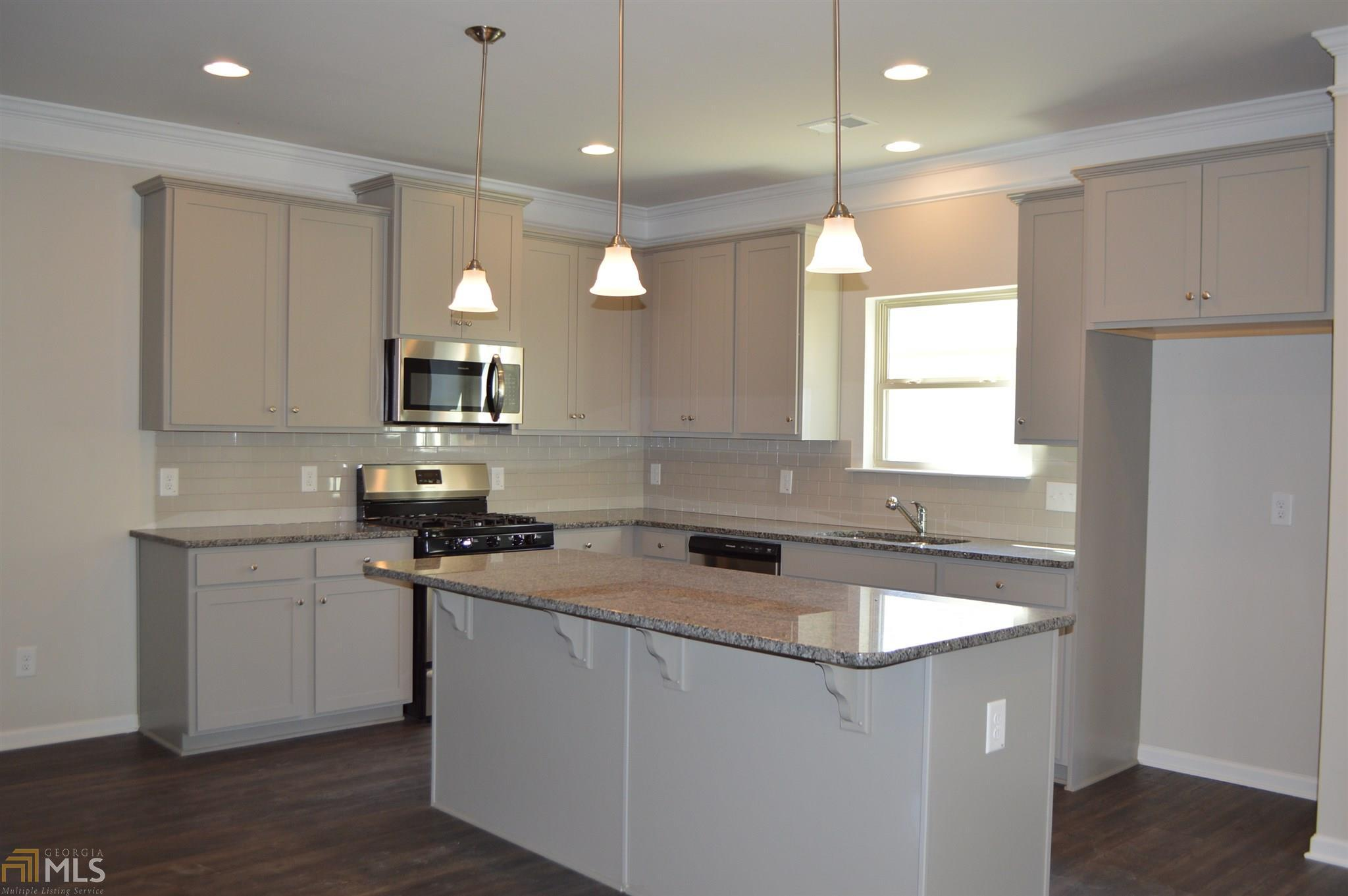 Kitchen-in-The Bayfield-at-Woodbury Estates at Newnan Crossing-in-Newnan