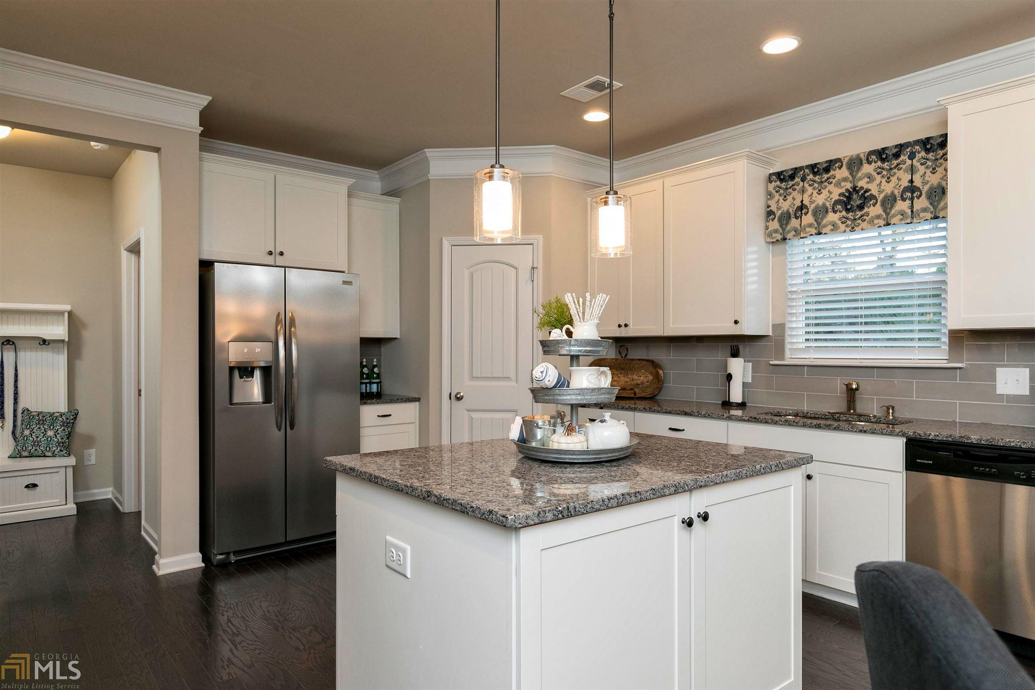 Kitchen-in-The Sydney-at-Woodbury Estates at Newnan Crossing-in-Newnan