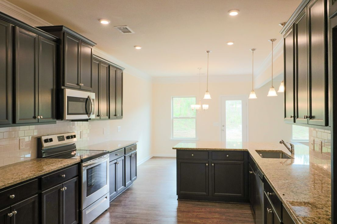 Kitchen featured in The Ellijay By Smith Douglas Homes in Charlotte, NC