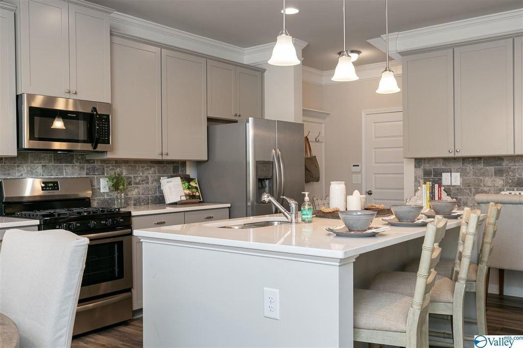 Kitchen featured in The Buffington G By Smith Douglas Homes in Huntsville, AL