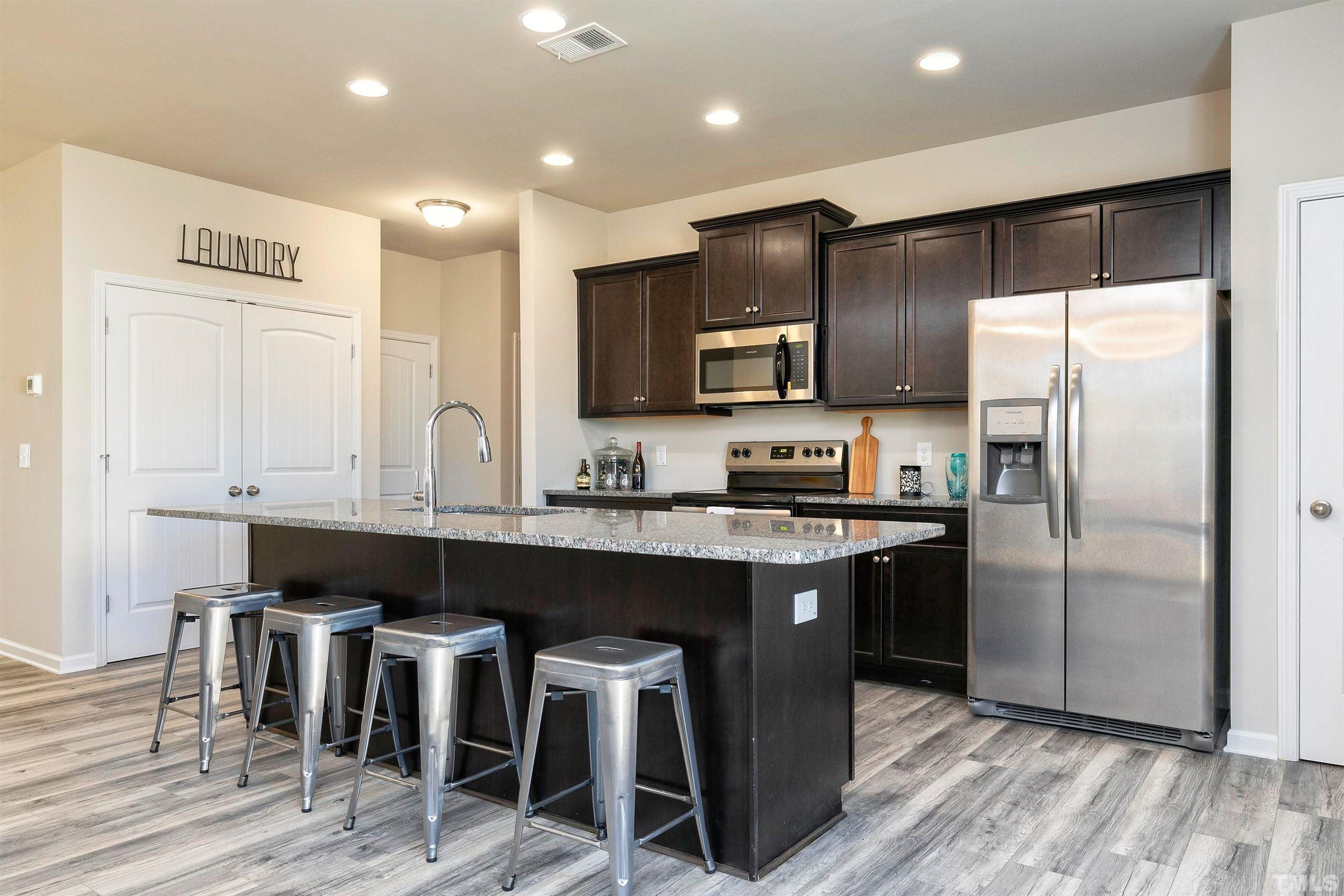 Kitchen featured in The Phoenix By Smith Douglas Homes in Goldsboro, NC