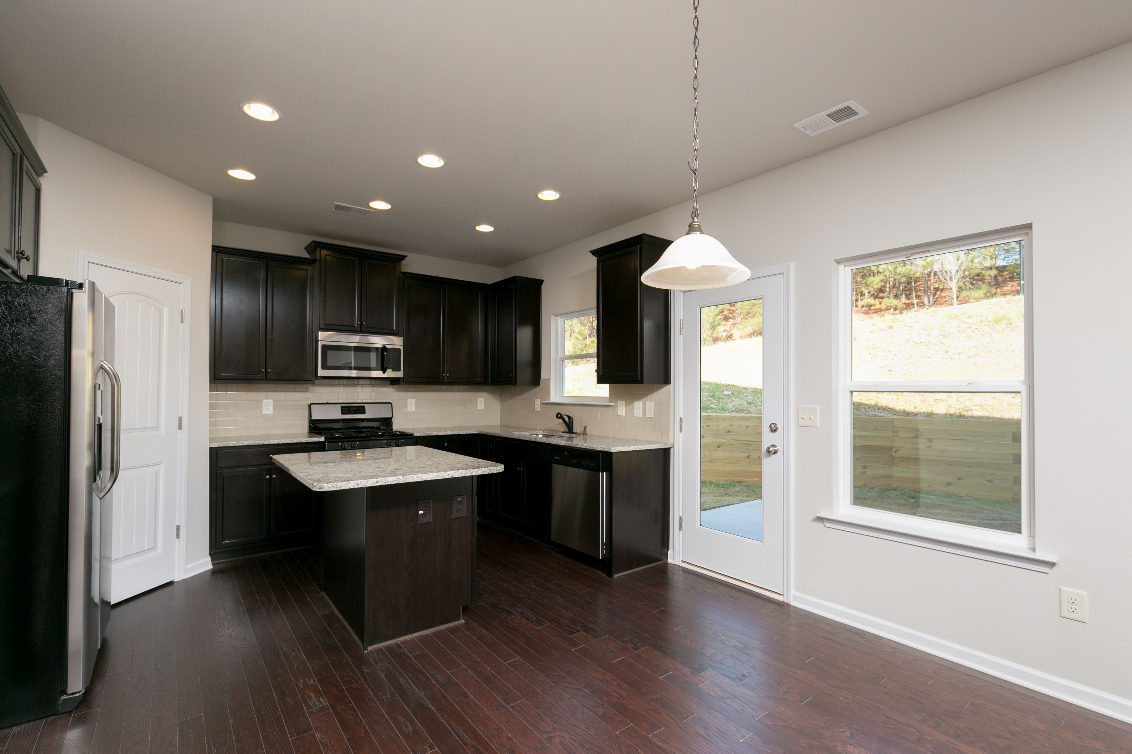 Kitchen featured in The Benson By Smith Douglas Homes in Anniston, AL
