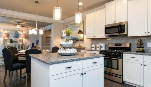 Kitchen-in-The Sydney-at-Woodbury Estates at Newnan Crossing-in-Newnan