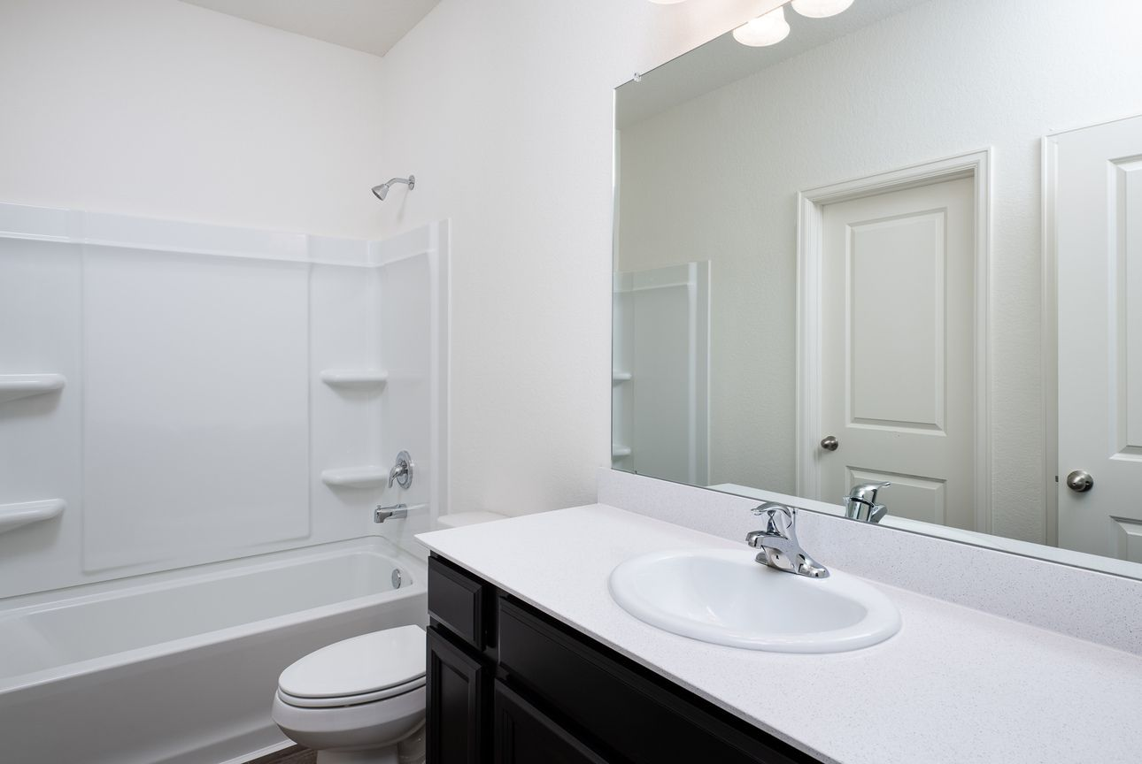 Bathroom featured in the Dawn By Starlight Homes in Houston, TX