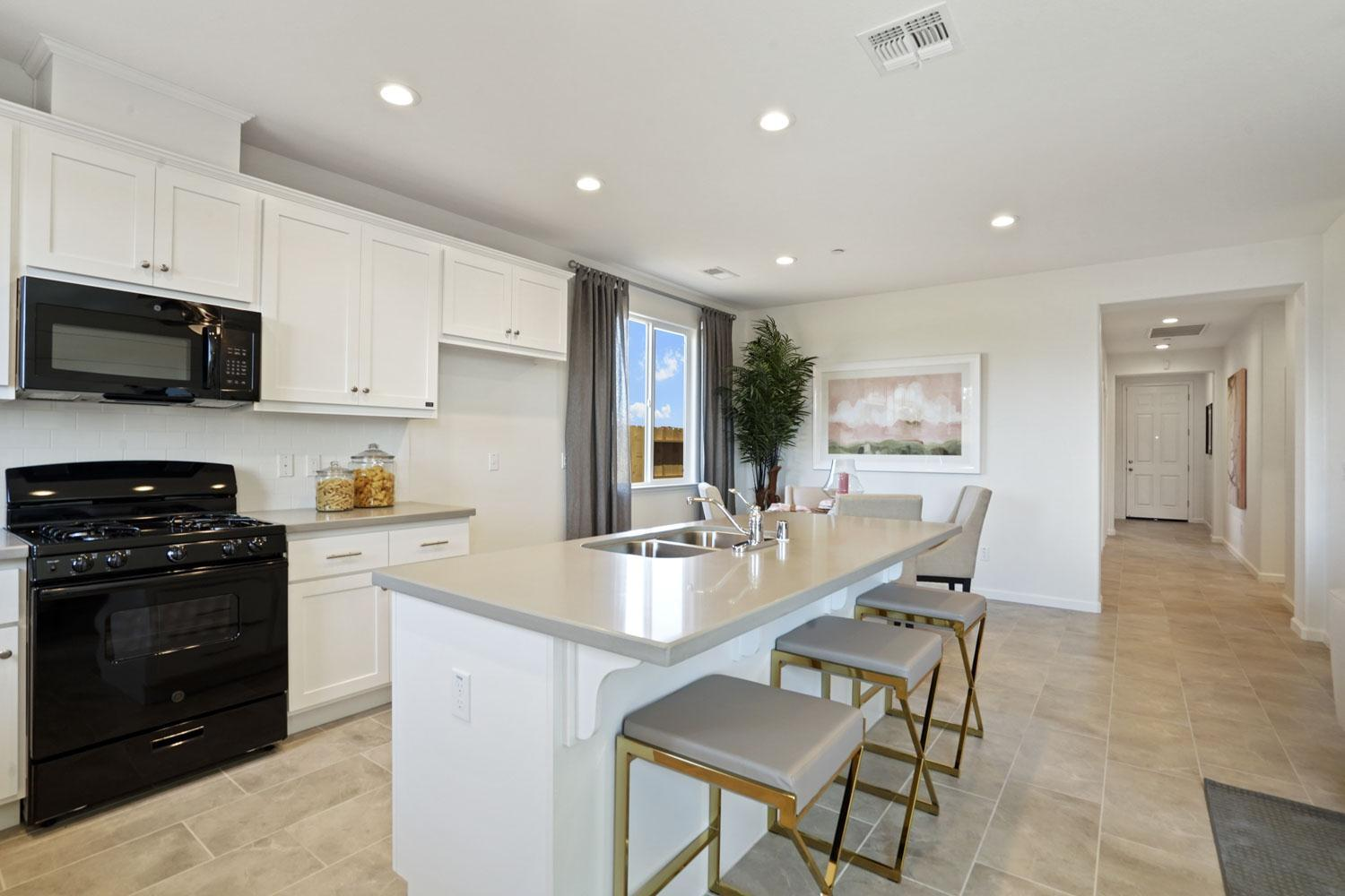 Kitchen featured in The Rainier By Stonefield Home in Merced, CA