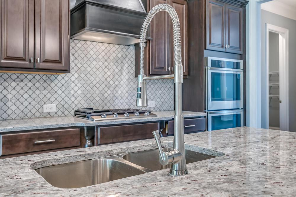 Kitchen featured in the Highland By Stone Martin Builders in Montgomery, AL