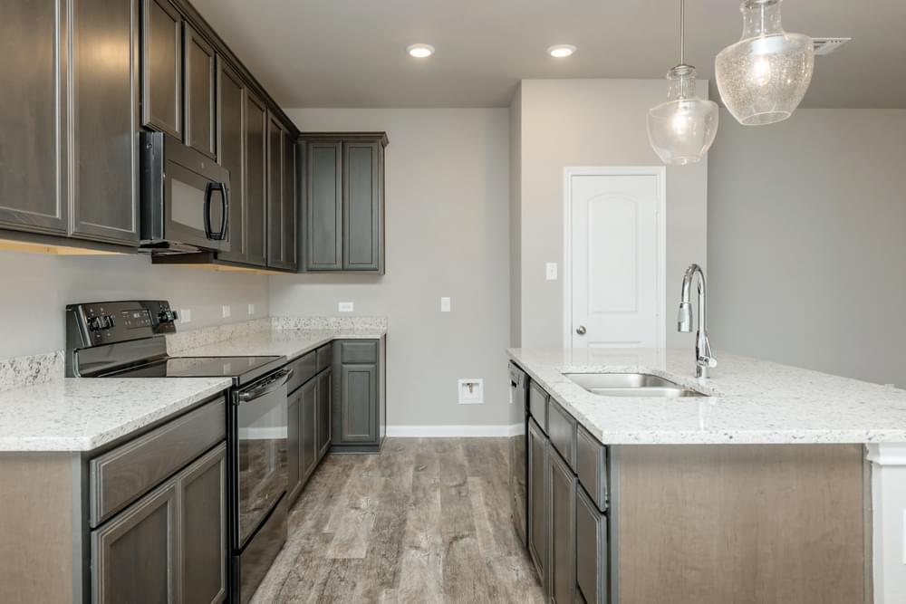 Kitchen featured in the Dexter I By Stylecraft Builders in Bryan-College Station, TX
