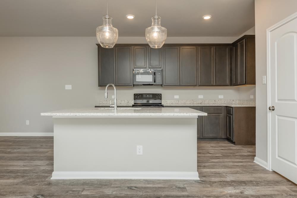Kitchen featured in the Dexter II By Stylecraft Builders in Bryan-College Station, TX