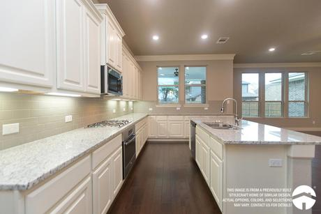 Kitchen-in-E-2478-at-Grand Lakes Estates - One Acre Homesites-in-Montgomery
