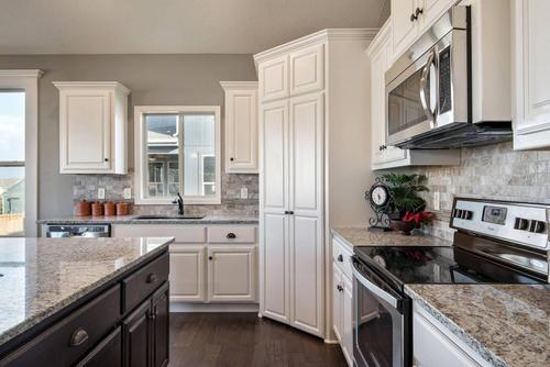 Kitchen-in-The Carbondale-at-Villas at Chapman Farms-in-Blue Springs