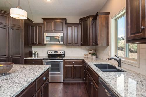 Kitchen-in-The Northfield-at-Ridgewood Place At Chapman Farms-in-Blue Springs