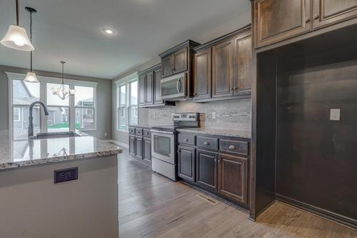 Kitchen-in-The Sequoia-at-Ridgewood Place At Chapman Farms-in-Blue Springs