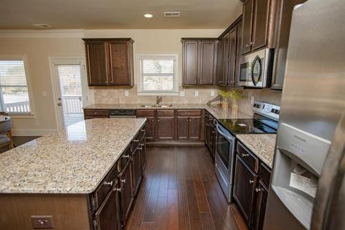 Kitchen-in-Stephen Elliott Homes  The Chadwick-at-Hampton Place Estates-in-Covington