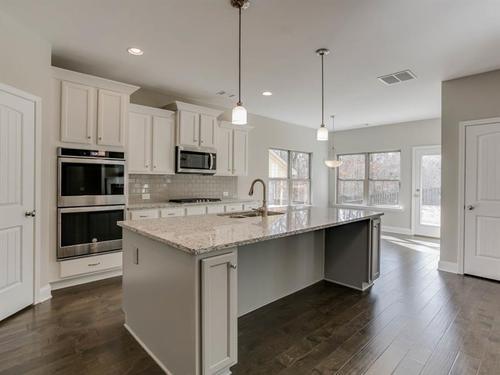 Kitchen-in-SR Homes  The Bennett-at-Gates at Limestone Creek-in-Gainesville