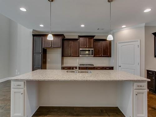Kitchen-in-SR Homes  The Millcreek-at-Gates at Limestone Creek-in-Gainesville