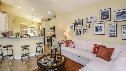 Greatroom-and-Dining-in-Saint Thomas-at-Eave's Bend at Artisan Lakes-in-Palmetto