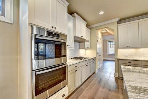 Kitchen-in-The Amhurst-at-Bellmoore Park-in-Johns Creek