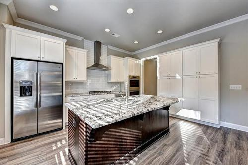 Kitchen-in-The Mansfield-at-Central Park at Deerfield Township-in-Alpharetta