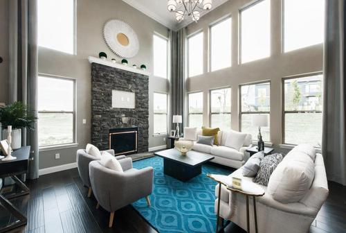 Greatroom-and-Dining-in-Lombardo Homes Harbor Plan-at-The Villages at Sandfort Farm-in-Saint Charles