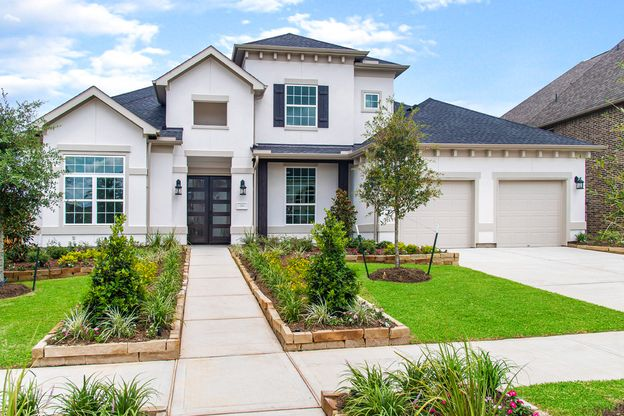 Elevation Image:Beautifully landscaped front yard welcomes you home