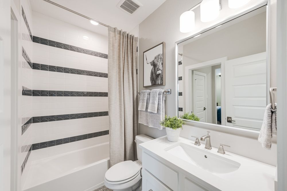 Bathroom featured in the Windsor By Trendmaker Homes in Houston, TX