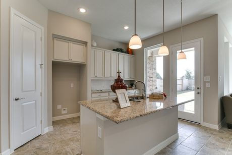 Kitchen-in-Brazos-at-Meridiana 55'-in-Iowa Colony