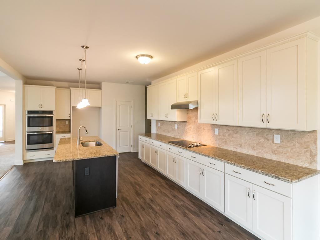 Kitchen-in-Alston Country-at-Sand Springs-in-Drums