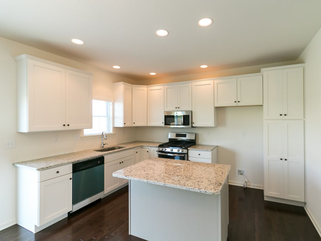 Kitchen featured in the Madison Traditional at Sand Springs By Tuskes Homes
