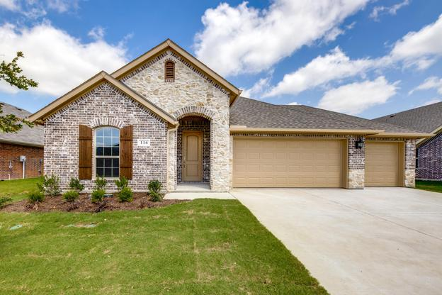 112 Olympic Lane Exterior:Beautiful brick and stone and fully landscaped exterior