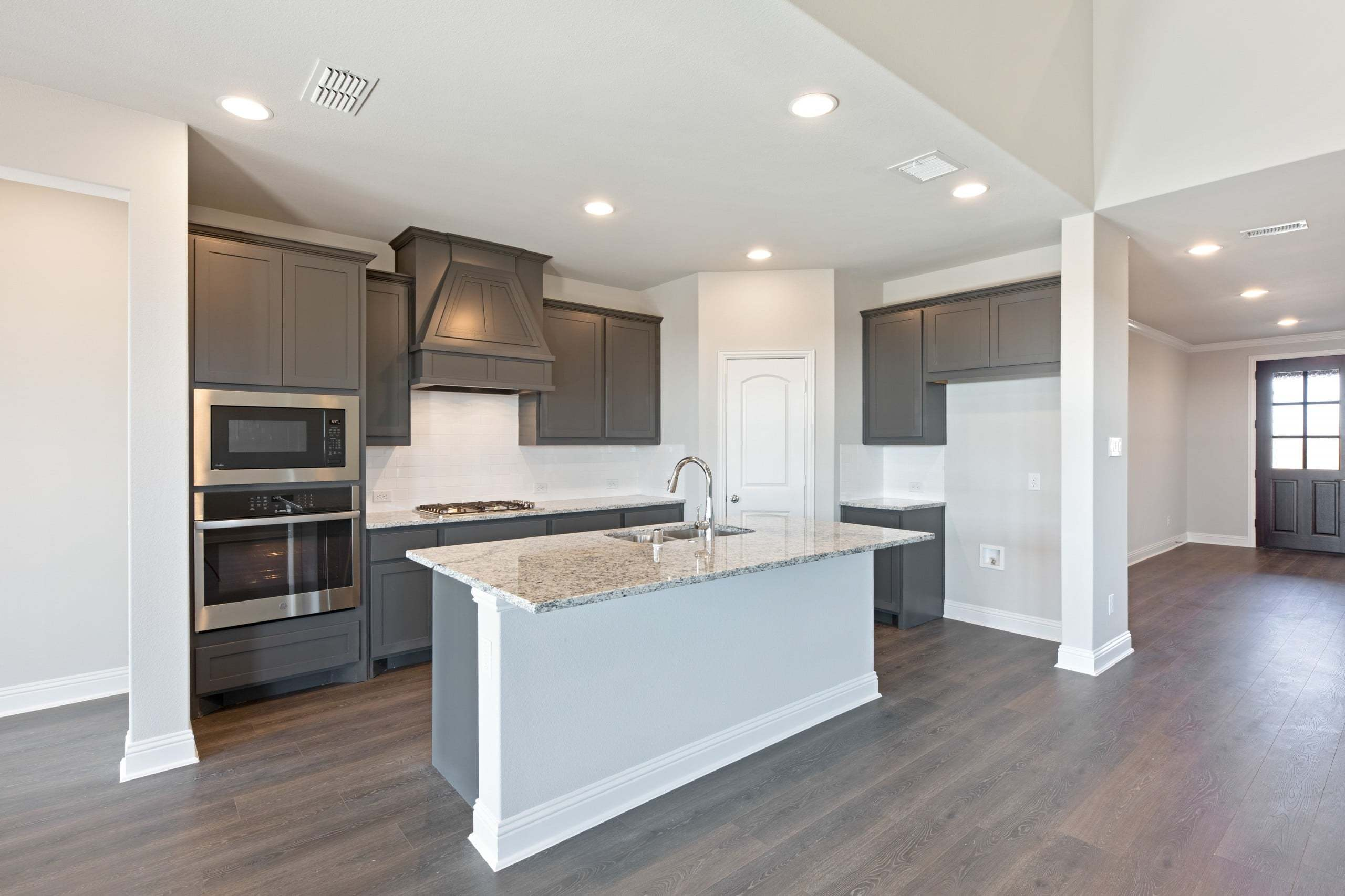 Kitchen featured in the Sabine By UnionMain Homes in Dallas, TX
