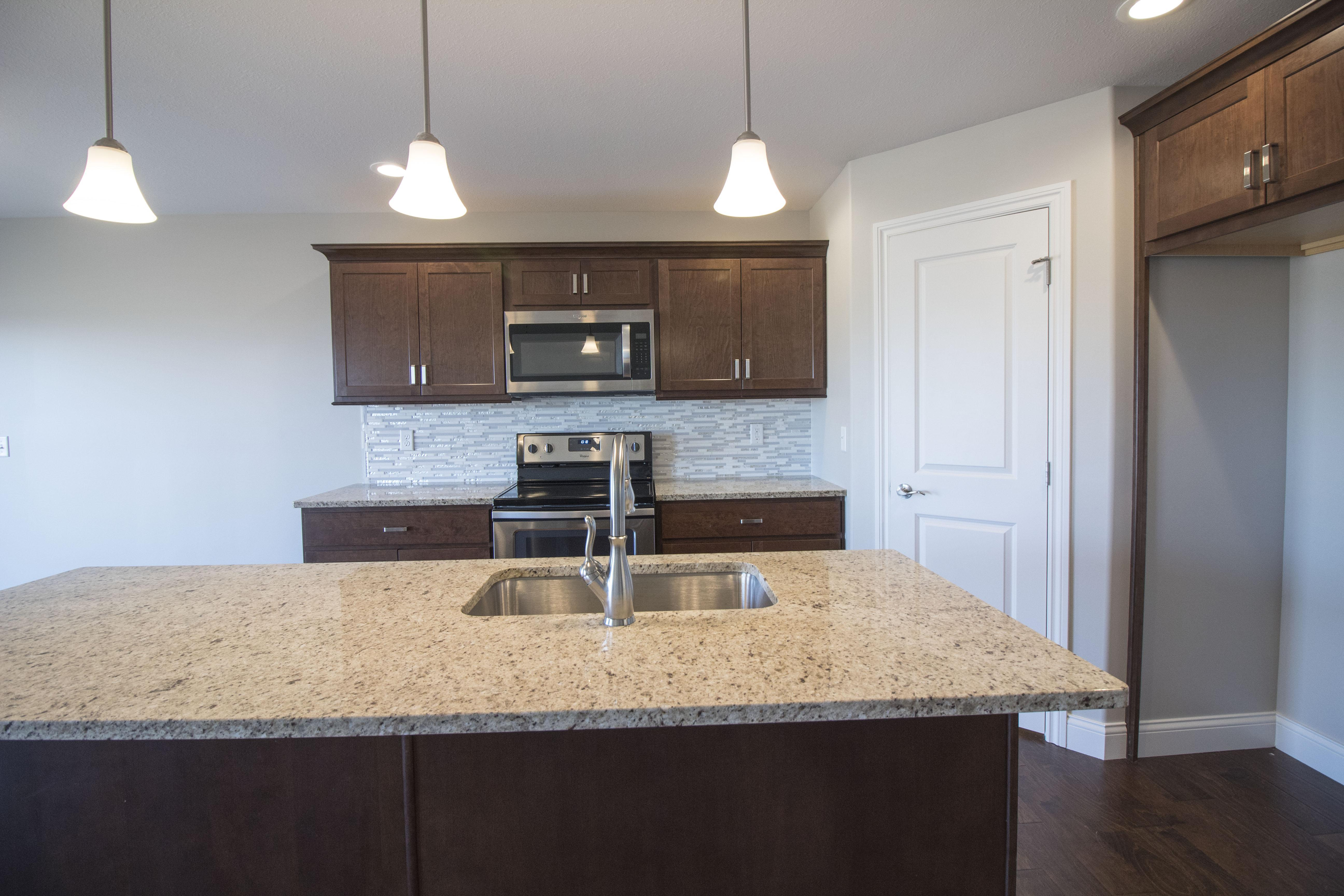 Kitchen featured in the Douglas II By Unlimited Homes in Champaign-Urbana, IL