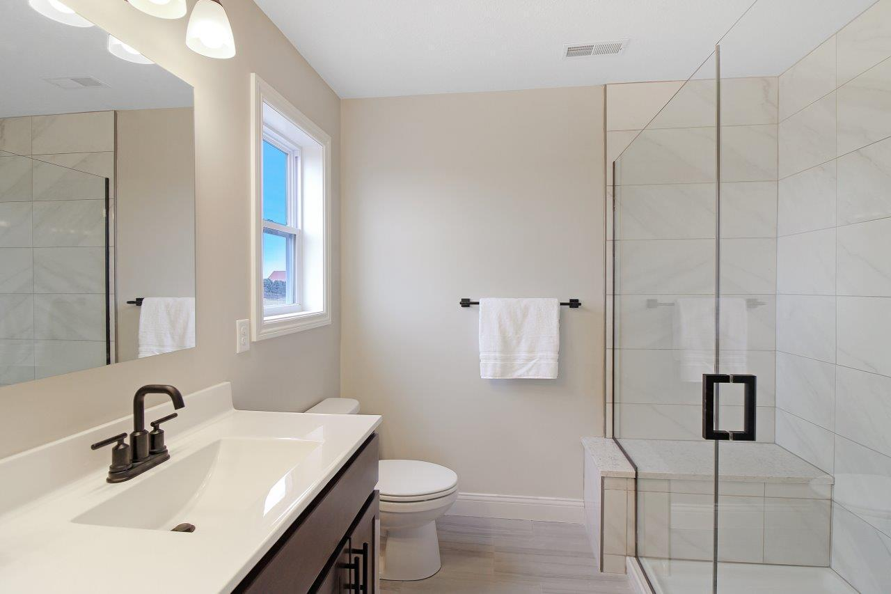 Bathroom featured in the Greenbriar 2 By Unlimited Homes in Champaign-Urbana, IL