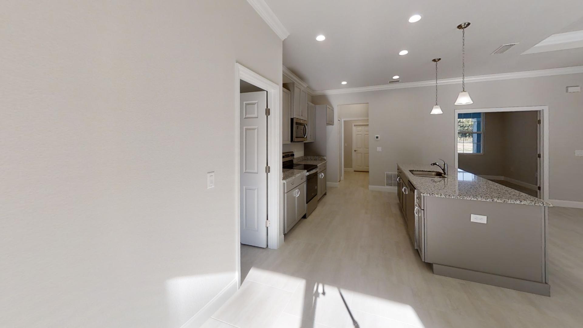 Kitchen featured in The Audubon By Vanacore Homes in Daytona Beach, FL